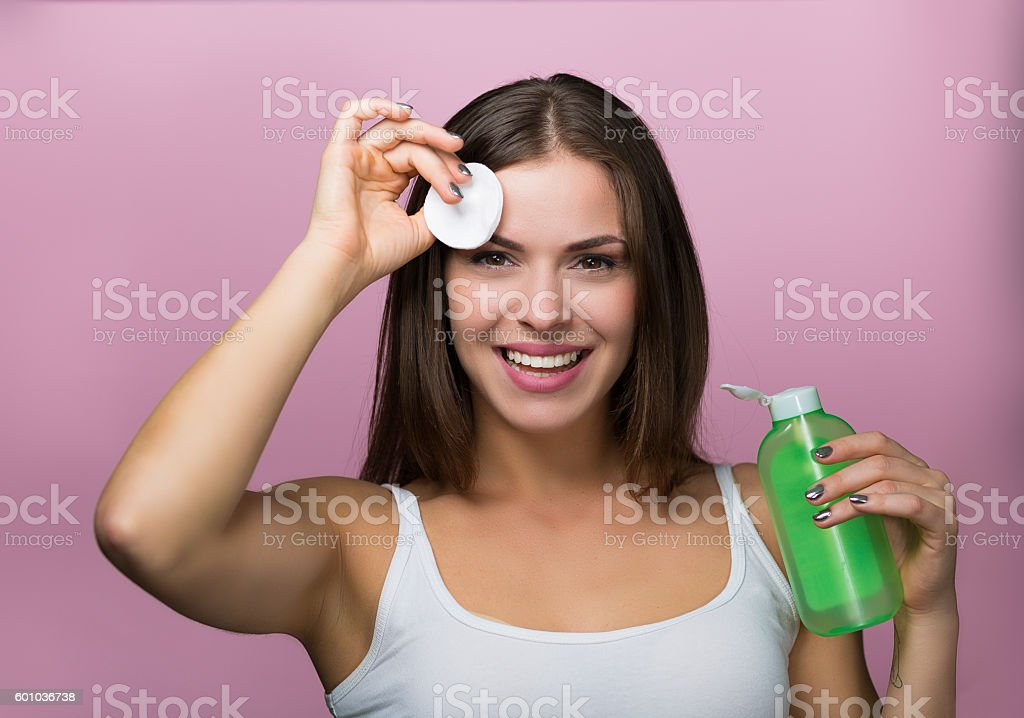 Pretty woman with a skin care product stock photo