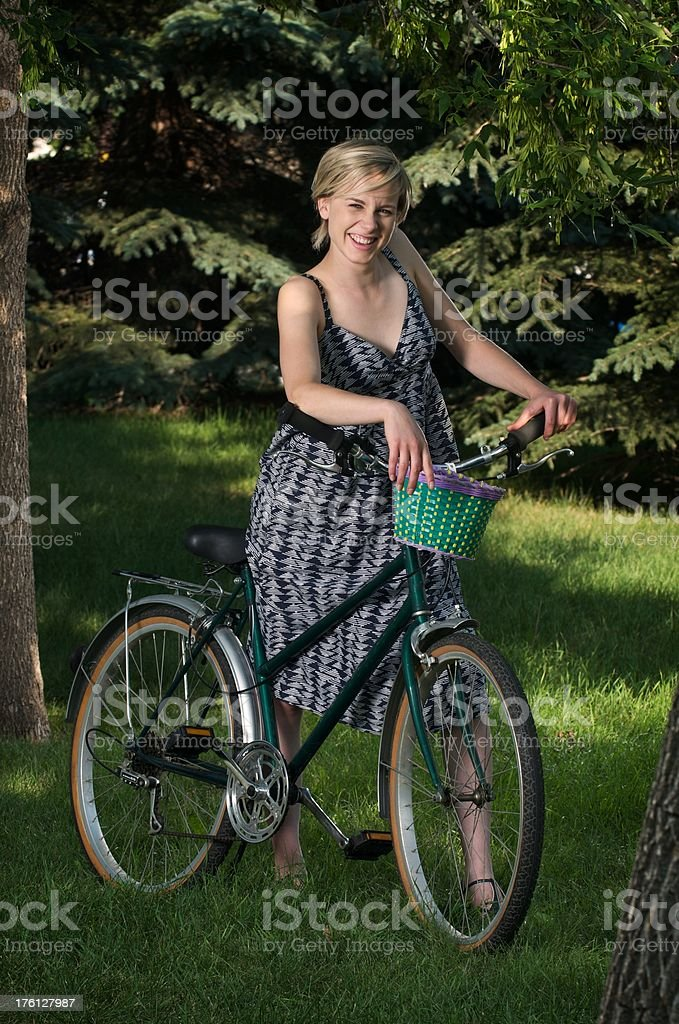 Pretty Woman With a Vintage Bicycle stock photo