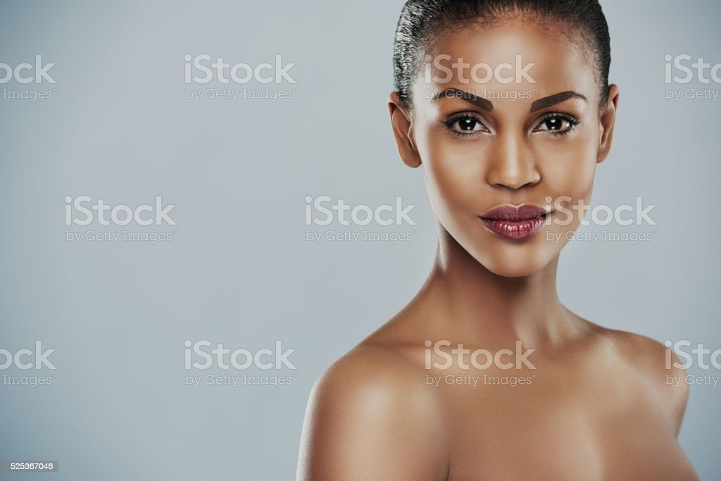 Pretty woman with bare shoulders with copy space stock photo