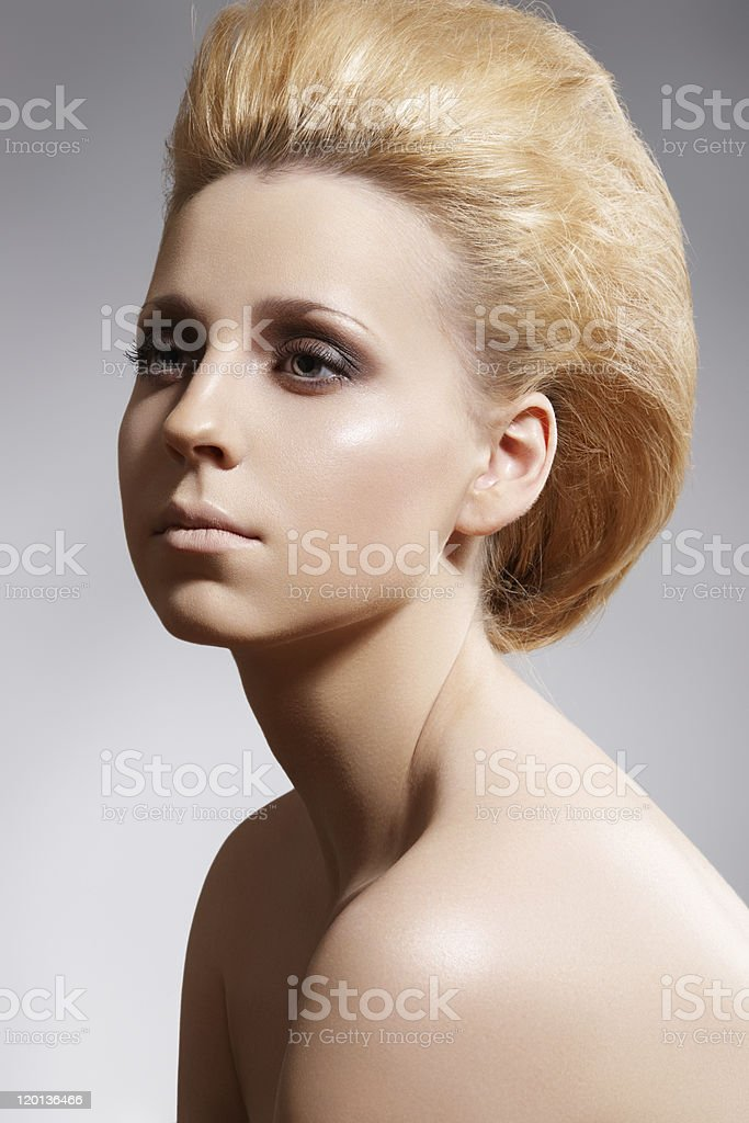 Pretty woman with blond volume hairstyle, clean skin stock photo