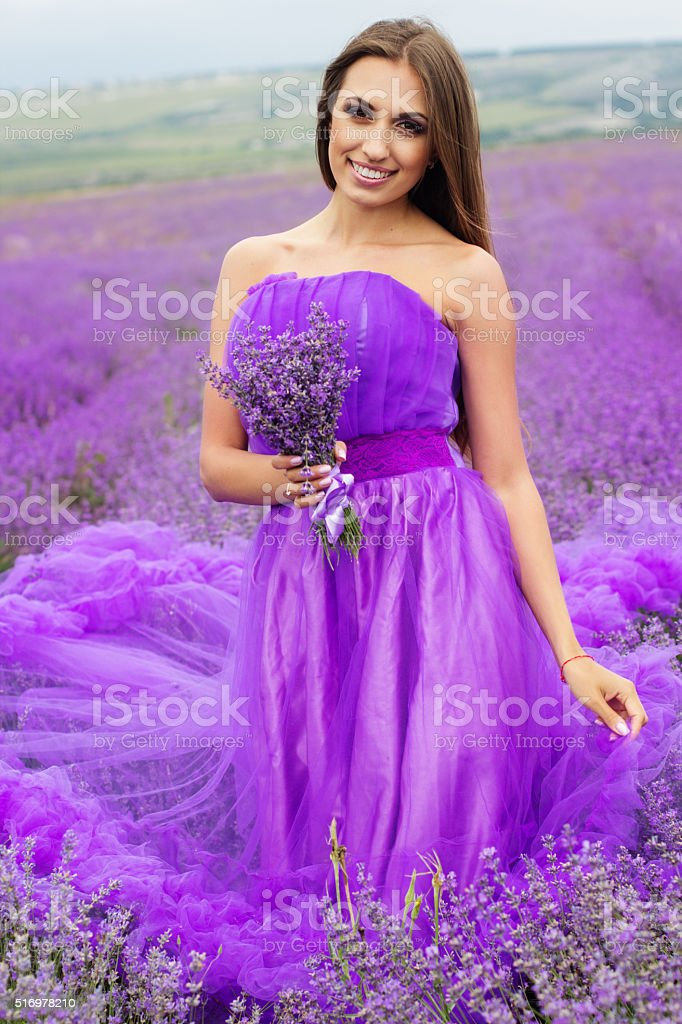 Pretty woman with bouquet of lavender flowers stock photo
