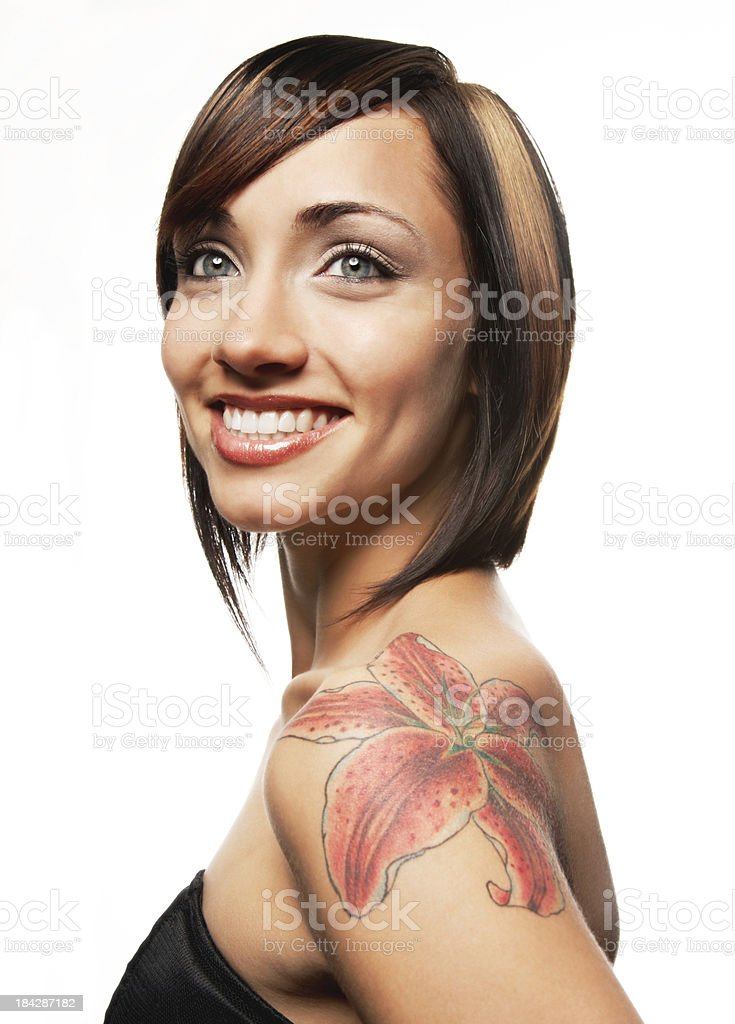 'Pretty Woman with Bright Smile, Highlighted Hair and Lily Tattoo' stock photo