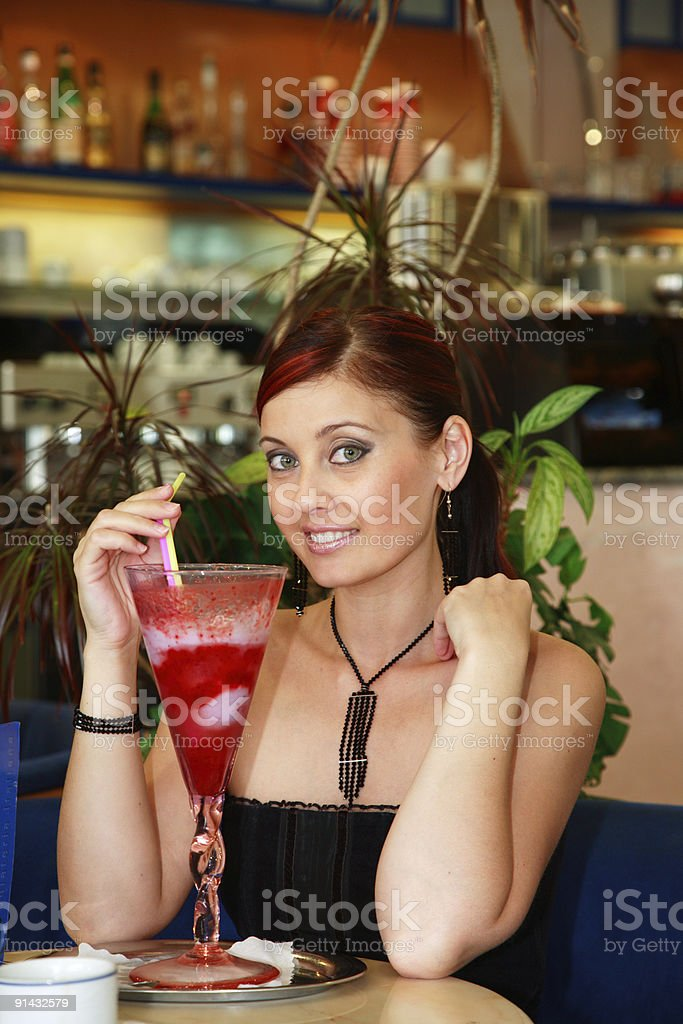 Pretty woman with cocktail. stock photo