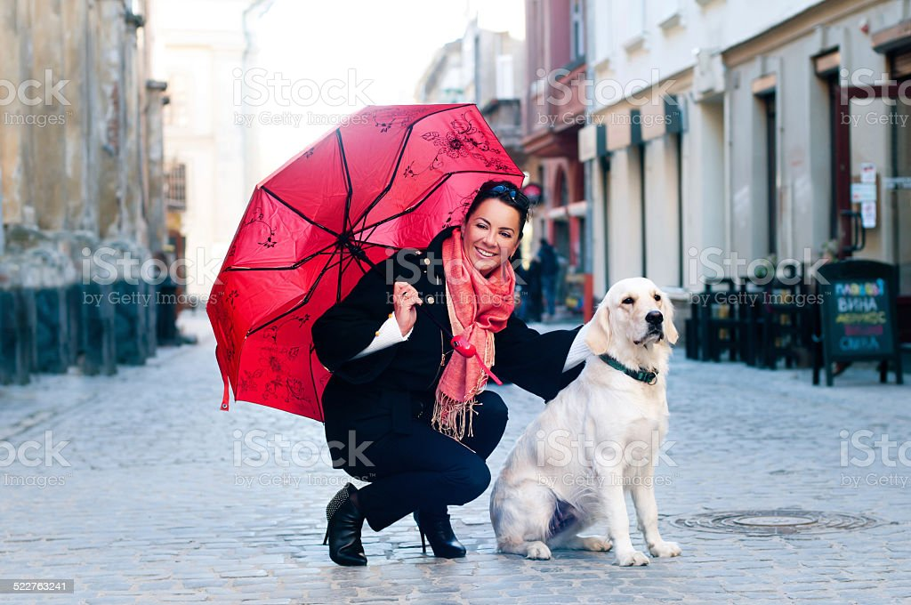 Pretty woman with dog portrait stock photo