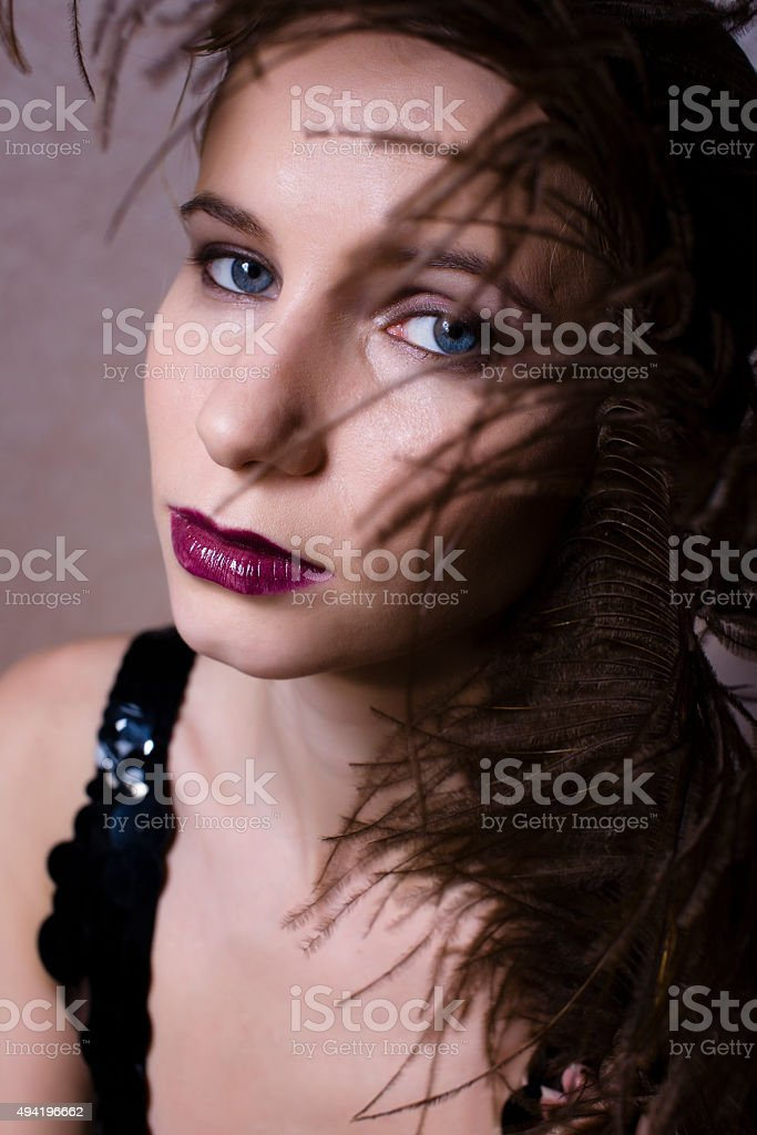 pretty woman with feather close up fashion 1940-1980 stock photo