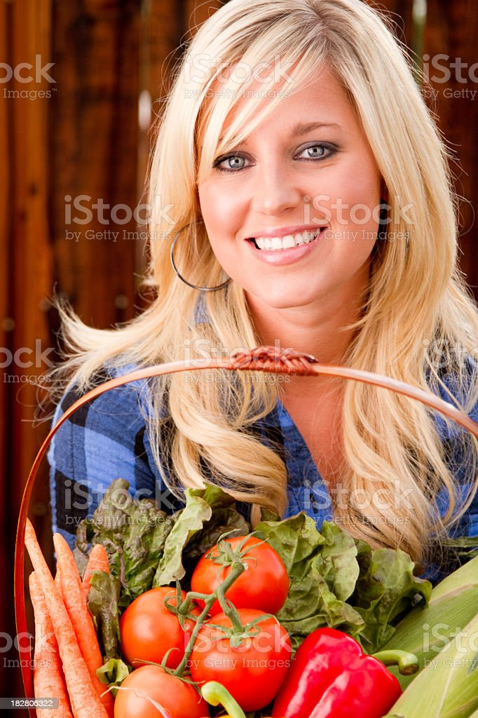 Pretty Woman With Fresh Picked Vegetables royalty-free stock photo