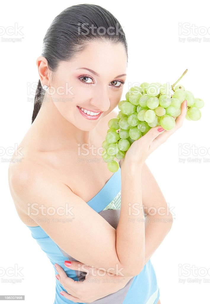 Pretty woman with grape on the white background royalty-free stock photo