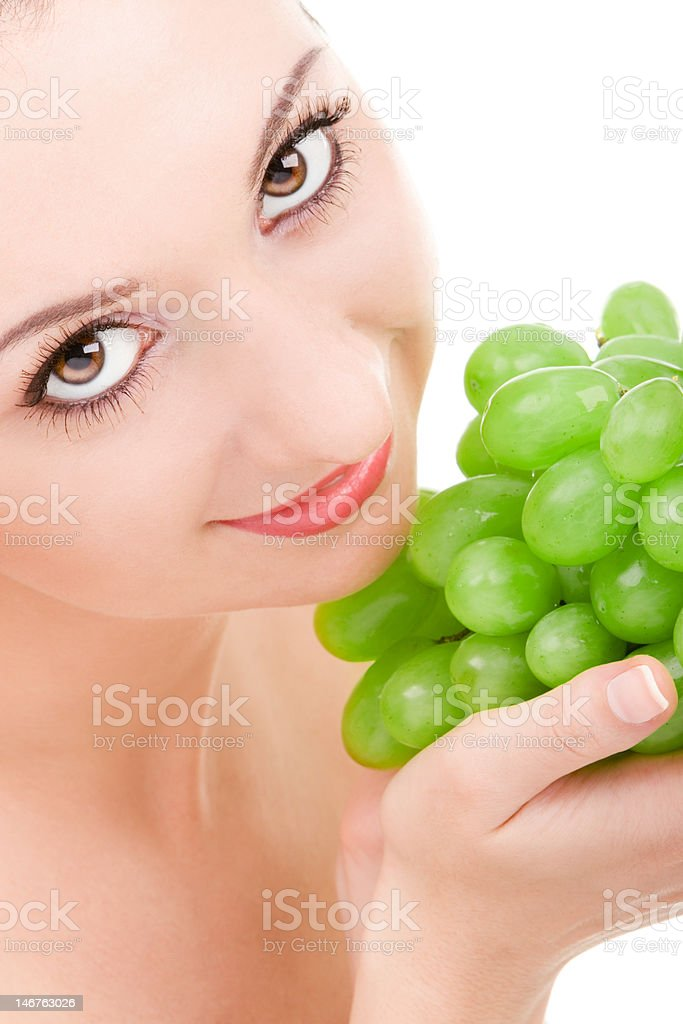 pretty woman with green grape royalty-free stock photo