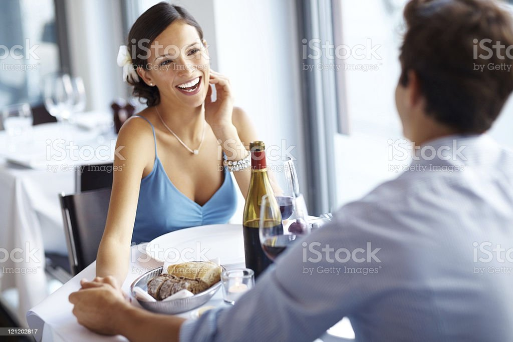 Pretty woman with her boyfriend at a restaurant royalty-free stock photo