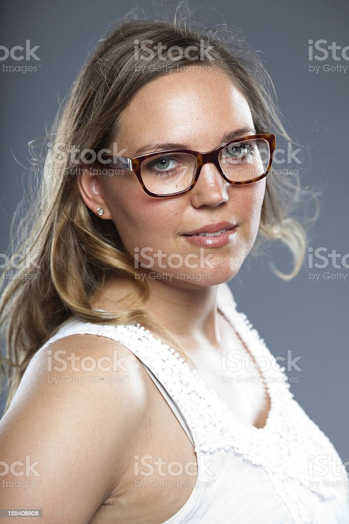 Pretty woman with long brown hair wearing glasses. royalty-free stock photo
