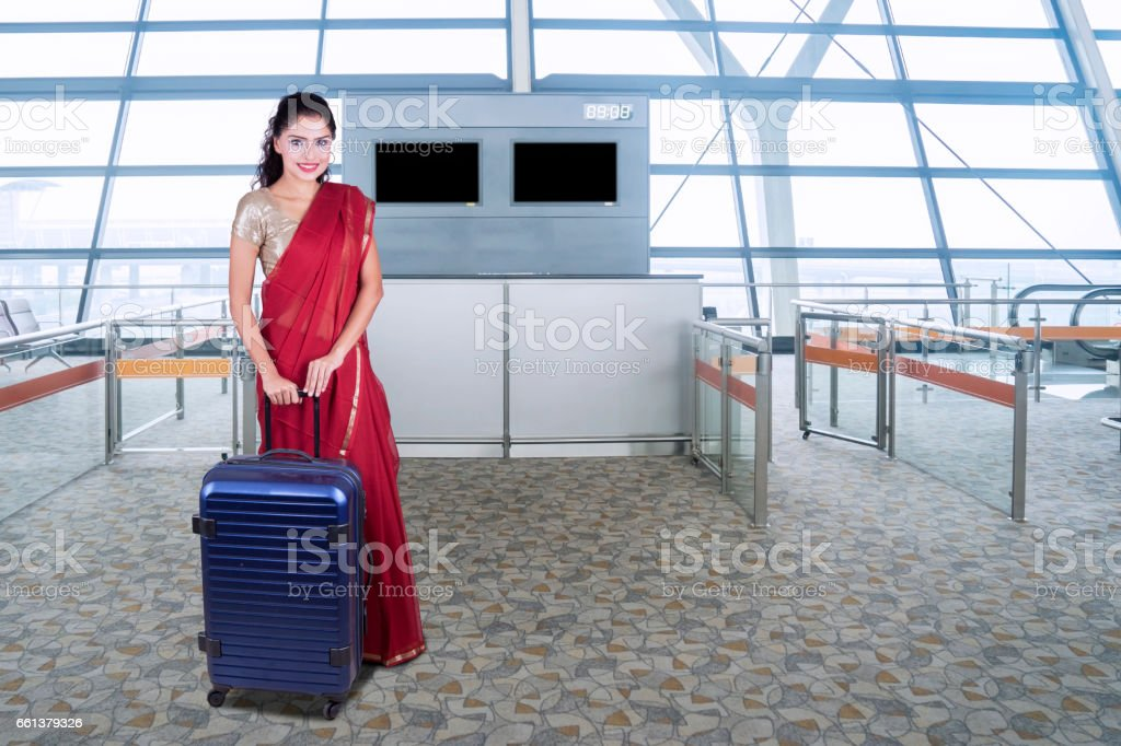 Pretty woman with saree clothes in airport stock photo