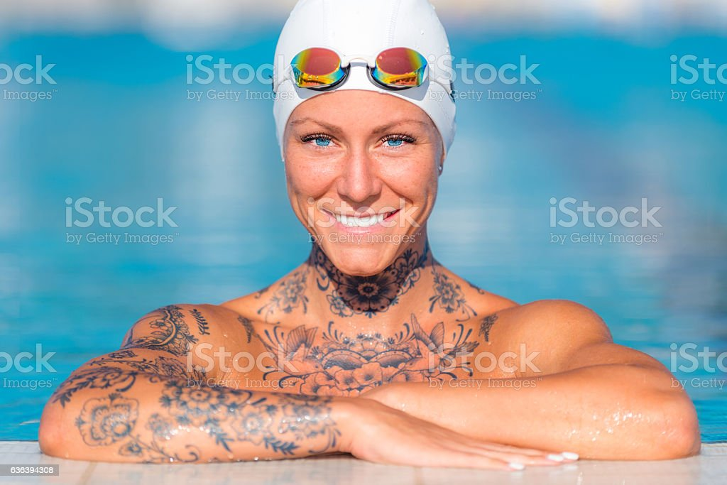 Pretty woman with tattoos, looking at the camera stock photo