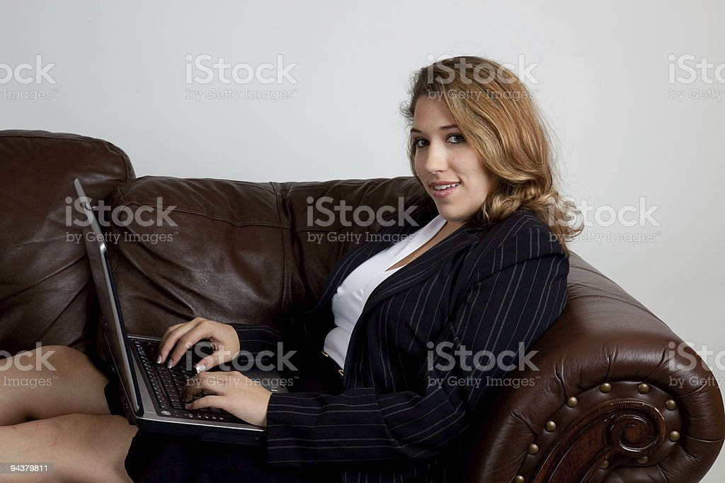 Pretty woman working on a laptop computer stock photo