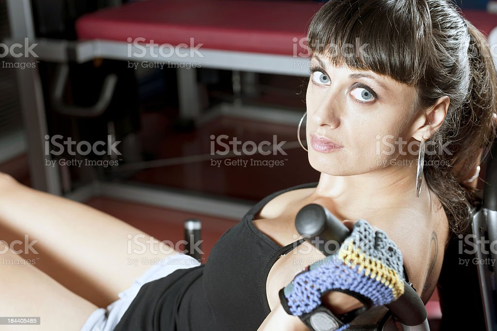 Pretty Woman Working Out in Fitness Club royalty-free stock photo