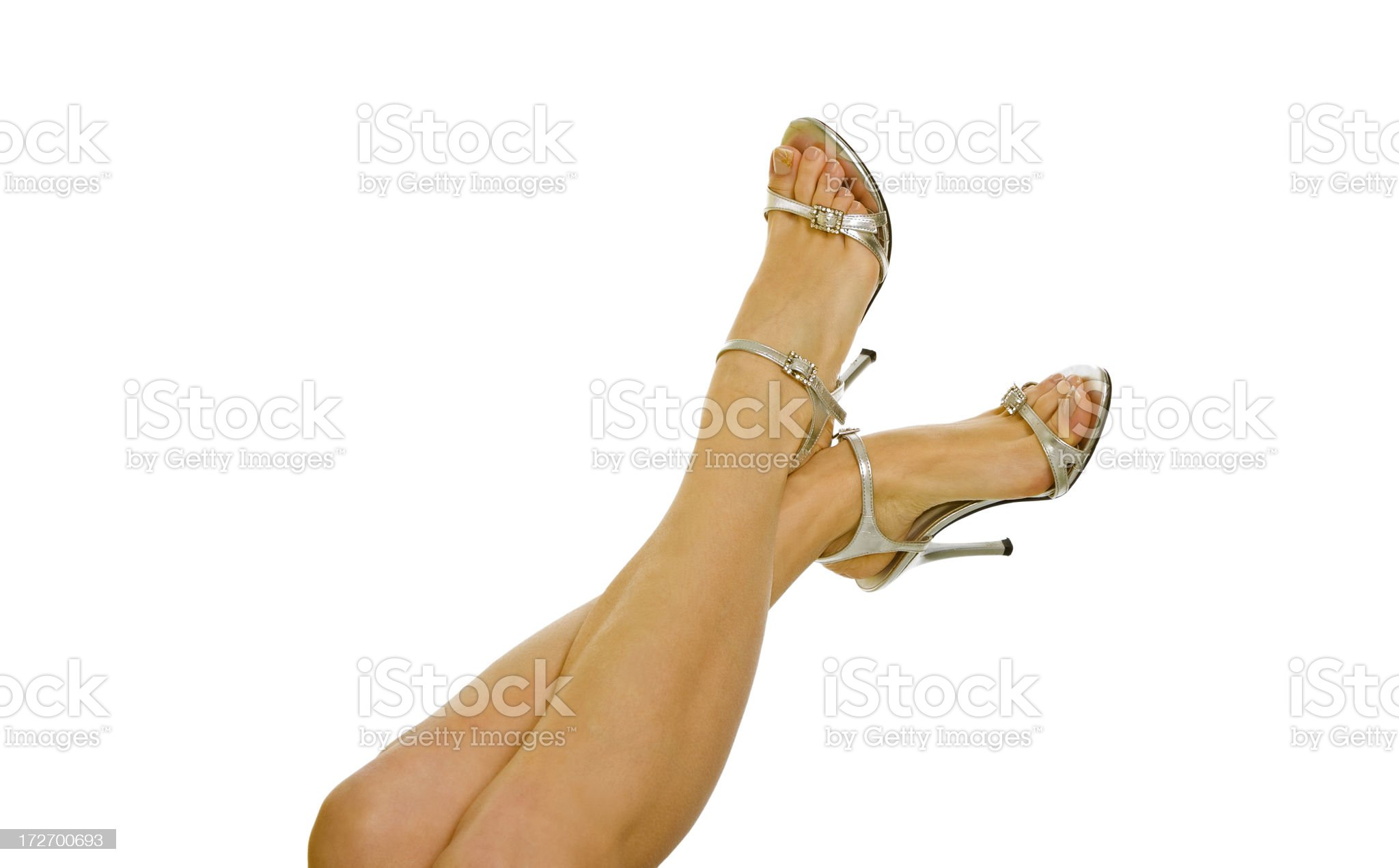 Pretty woman's legs isolated on white royalty-free stock photo