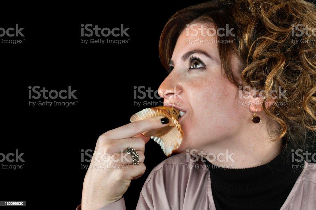 Pretty women eating cupcake royalty-free stock photo