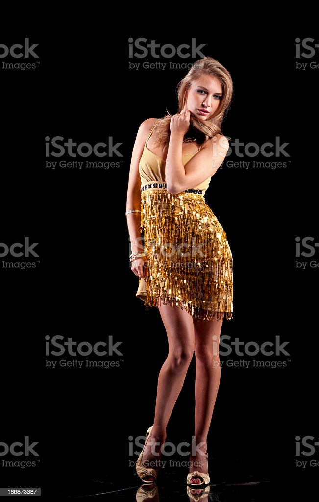 Pretty women in gold on black with long hair royalty-free stock photo