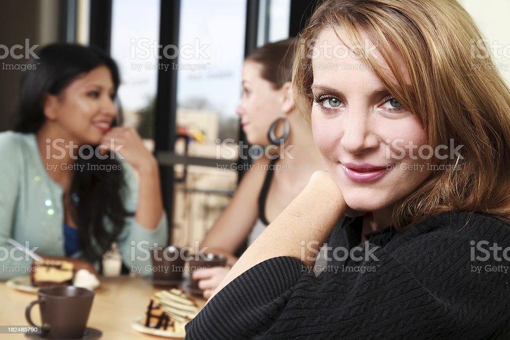 Pretty Women Looking Forward, With Friends at Coffee Shop royalty-free stock photo