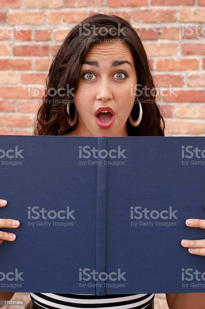 Pretty women looking over blank book shocked royalty-free stock photo