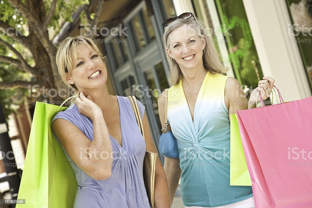 Pretty Women Out Shopping at Outdoor Shops royalty-free stock photo