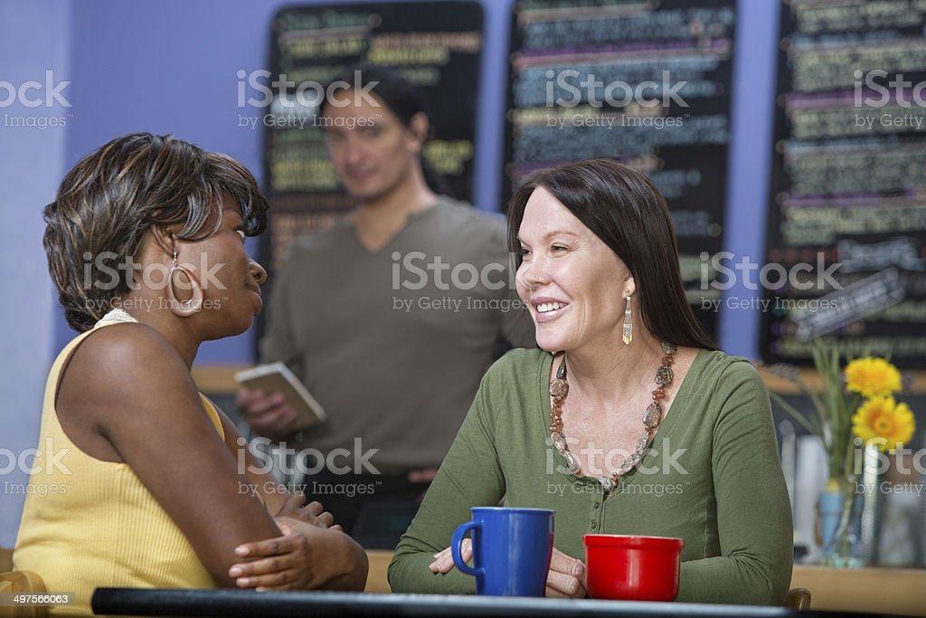 Pretty Women Talking stock photo