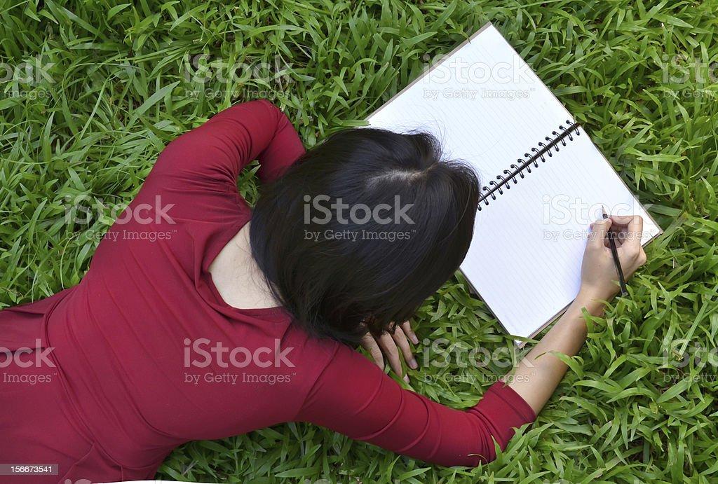 pretty women  writing book royalty-free stock photo