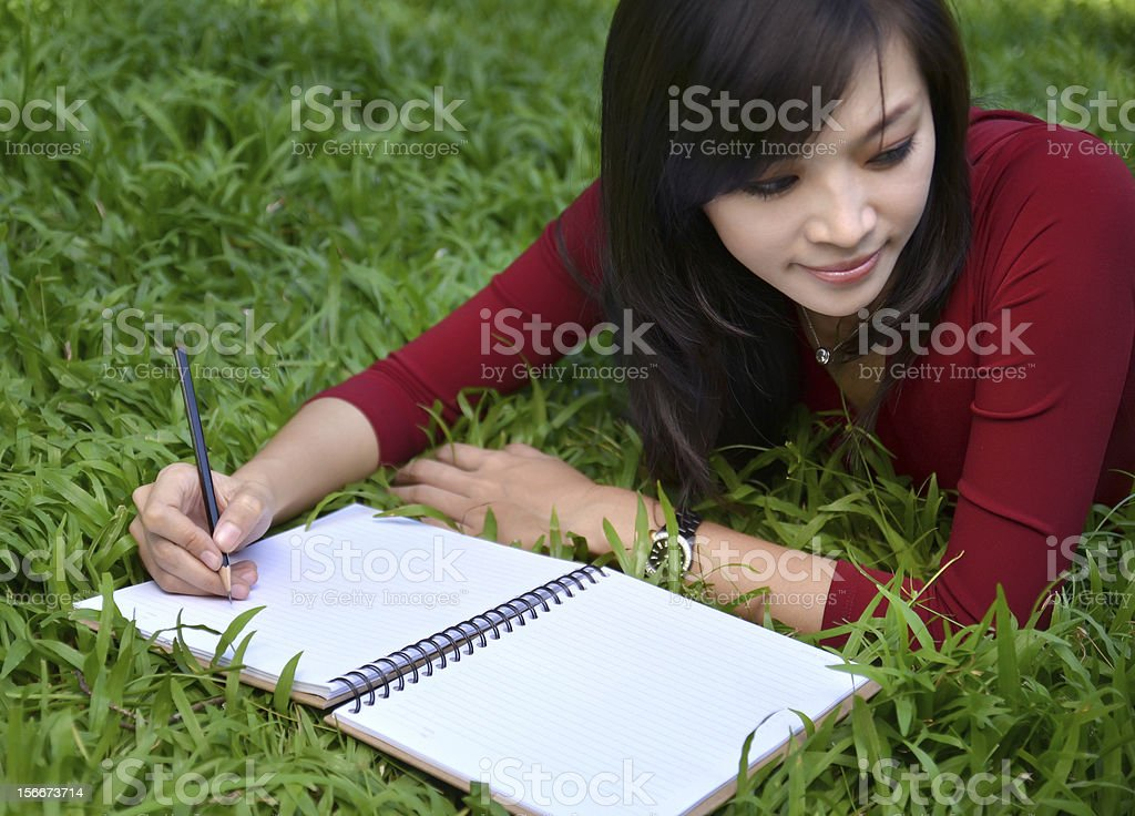 pretty women  writing book stock photo