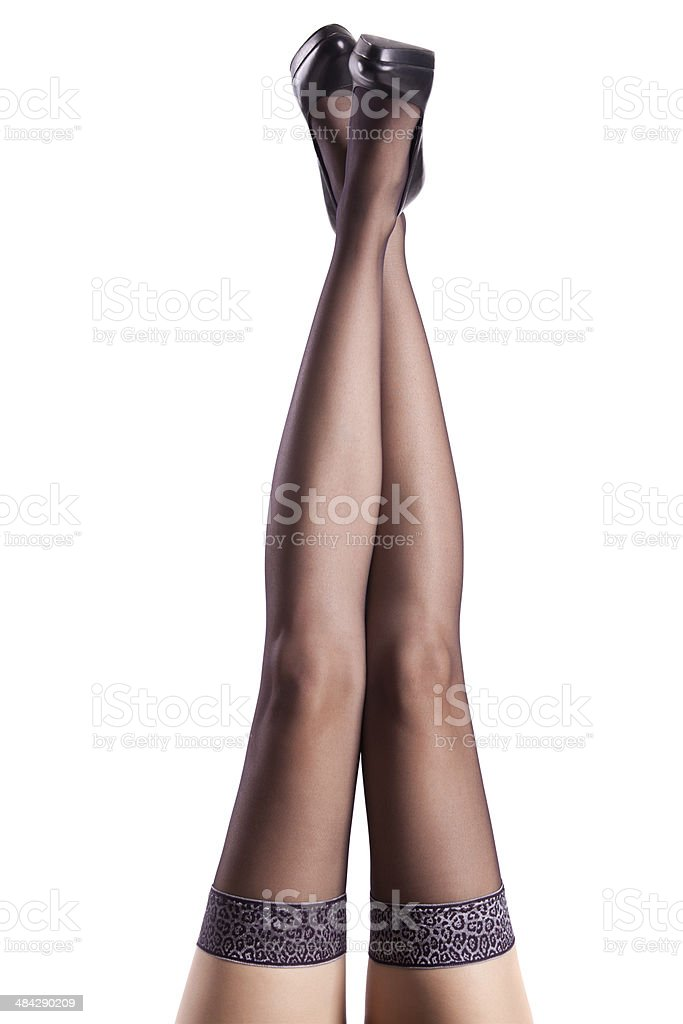 Pretty women's legs with elegant black stockings and high heels royalty-free stock photo