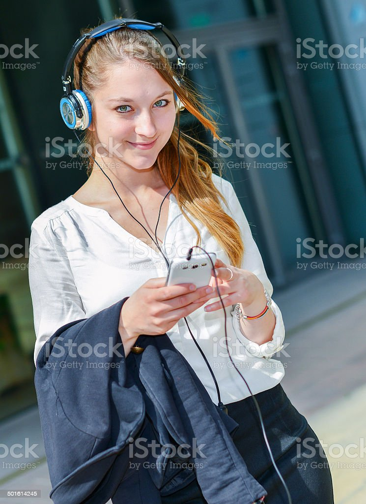 pretty worker listening to music in front her office royalty-free stock photo