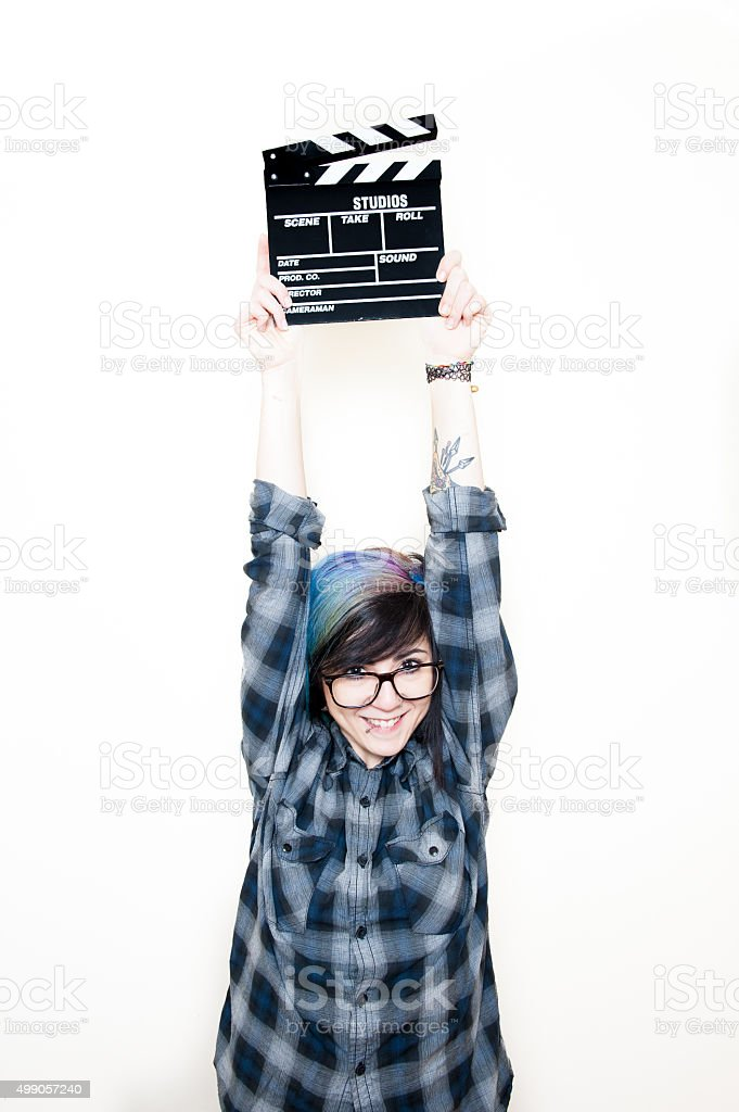 Pretty young alternative teen woman with movie clapper stock photo