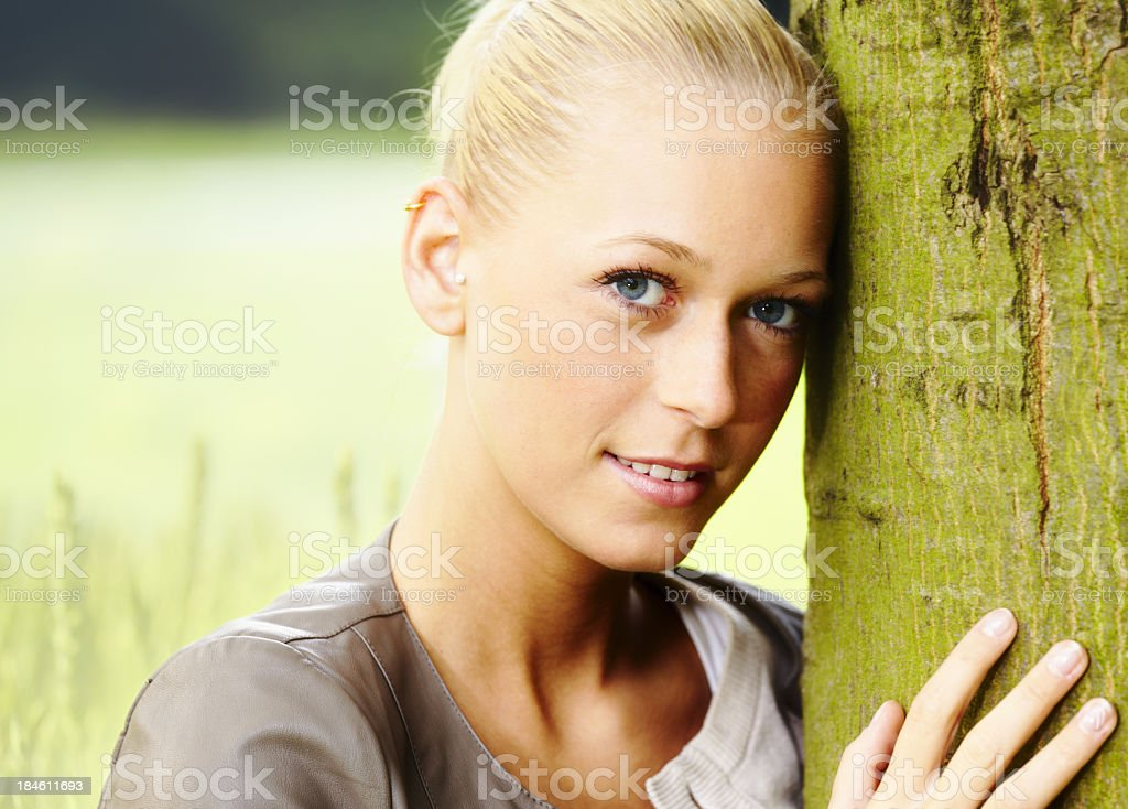 Pretty young blond girl in park royalty-free stock photo