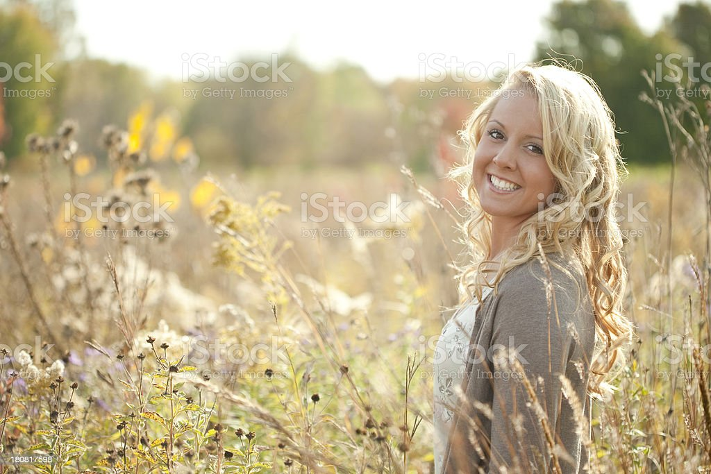 Pretty Young Blonde Girl Standing In A Field royalty-free stock photo