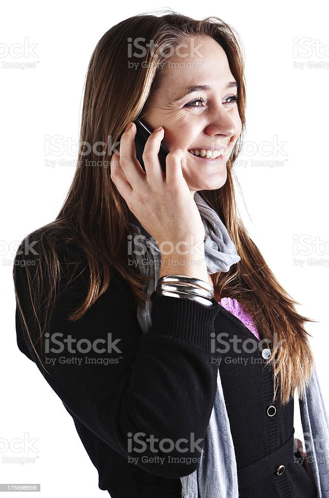 Pretty young blonde talking on cell phone, smiling happily stock photo