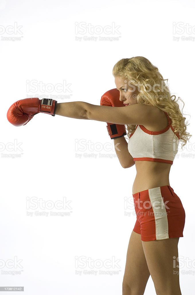 Pretty young blonde woman with red boxing gloves.3. royalty-free stock photo