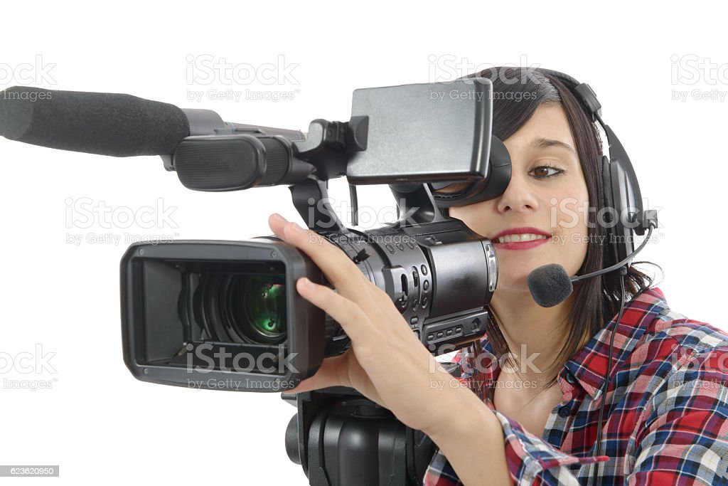 pretty young brunette girl with a professional camcorder, on whi stock photo