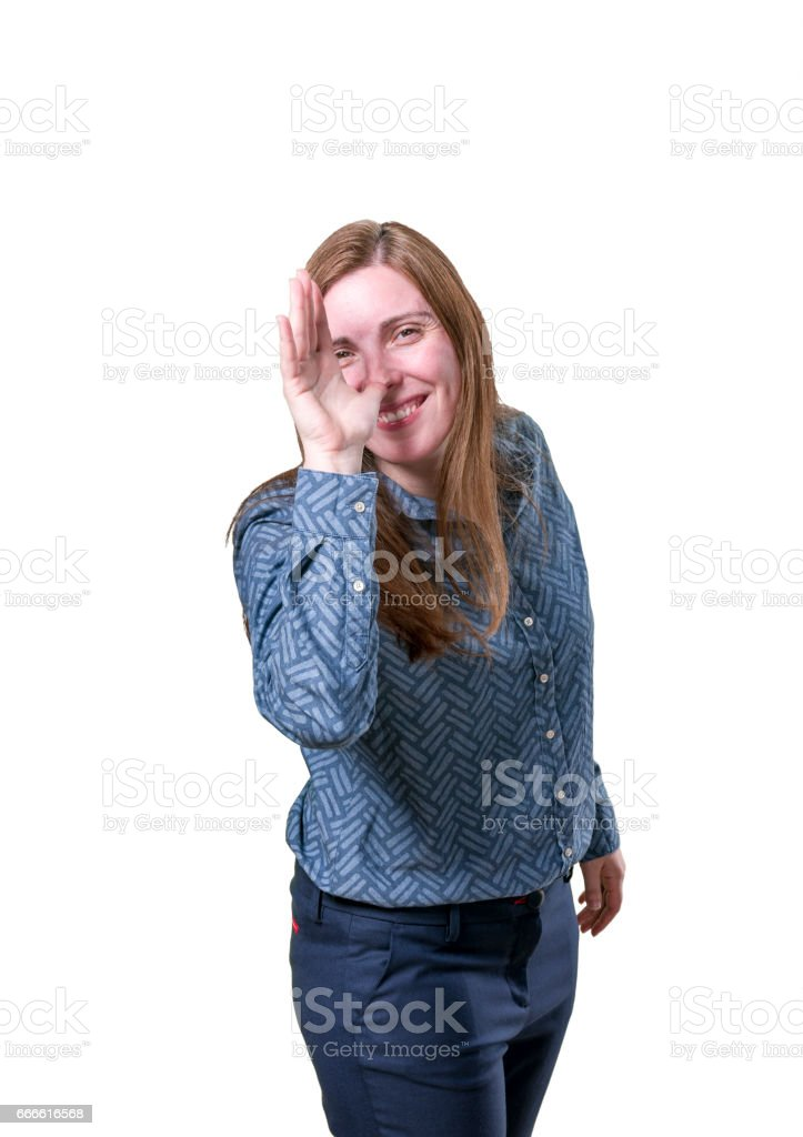 Pretty young business woman making a joke over white background stock photo