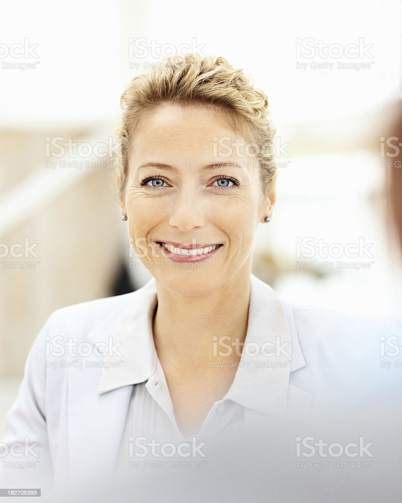 Pretty young business woman smiling at work royalty-free stock photo