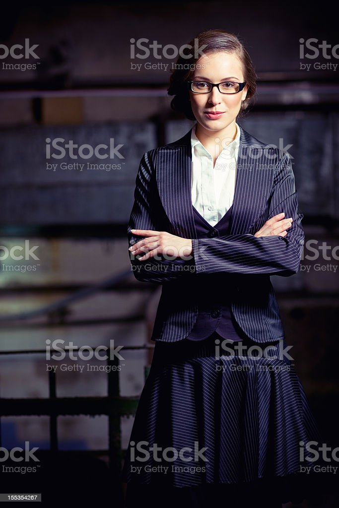 Pretty Young Businesswoman with eyeglasses and arms crossed royalty-free stock photo