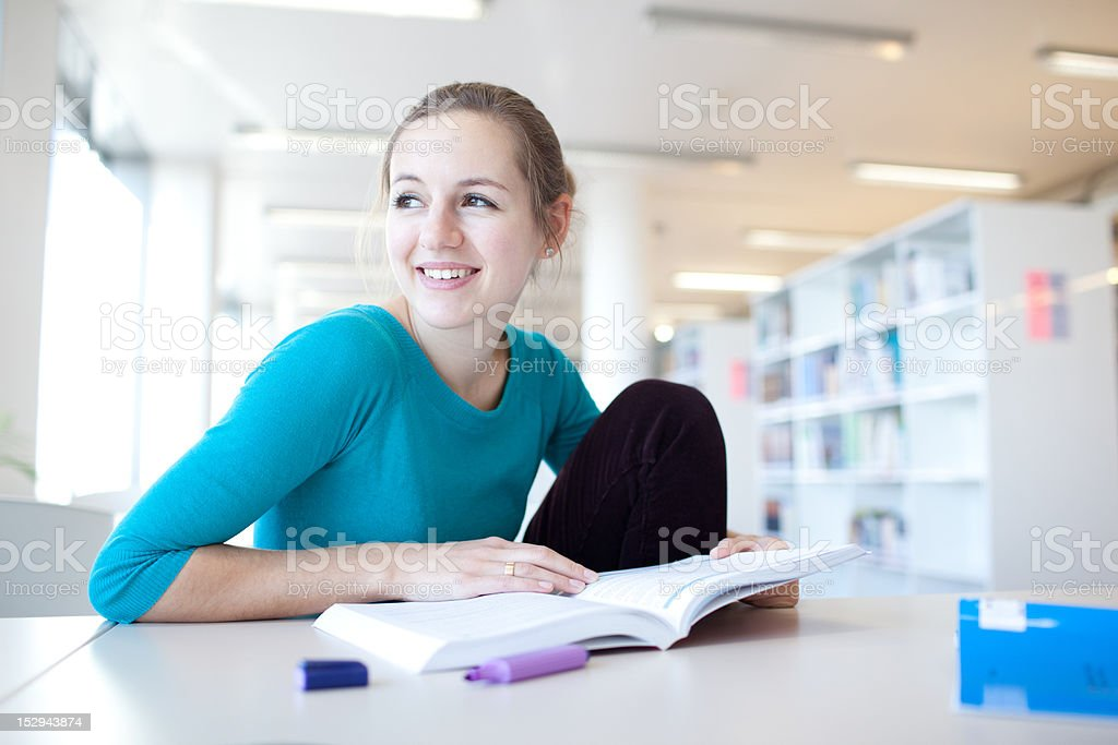 pretty young college student in a library royalty-free stock photo