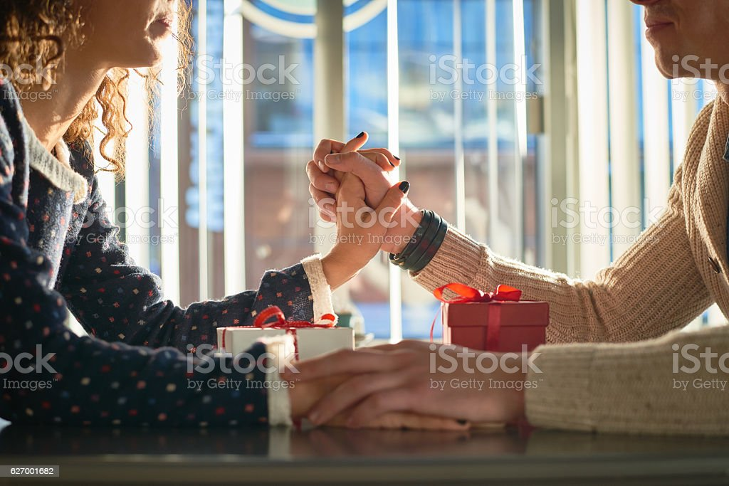 Pretty young couple exchanging presents stock photo