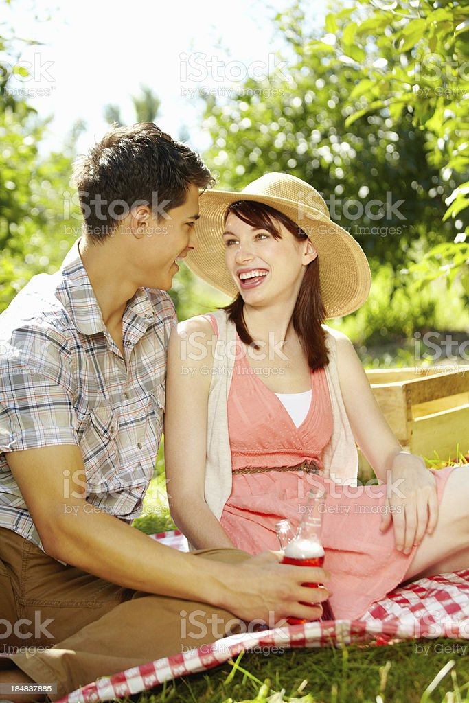 Pretty young couple having a lovely picnic royalty-free stock photo
