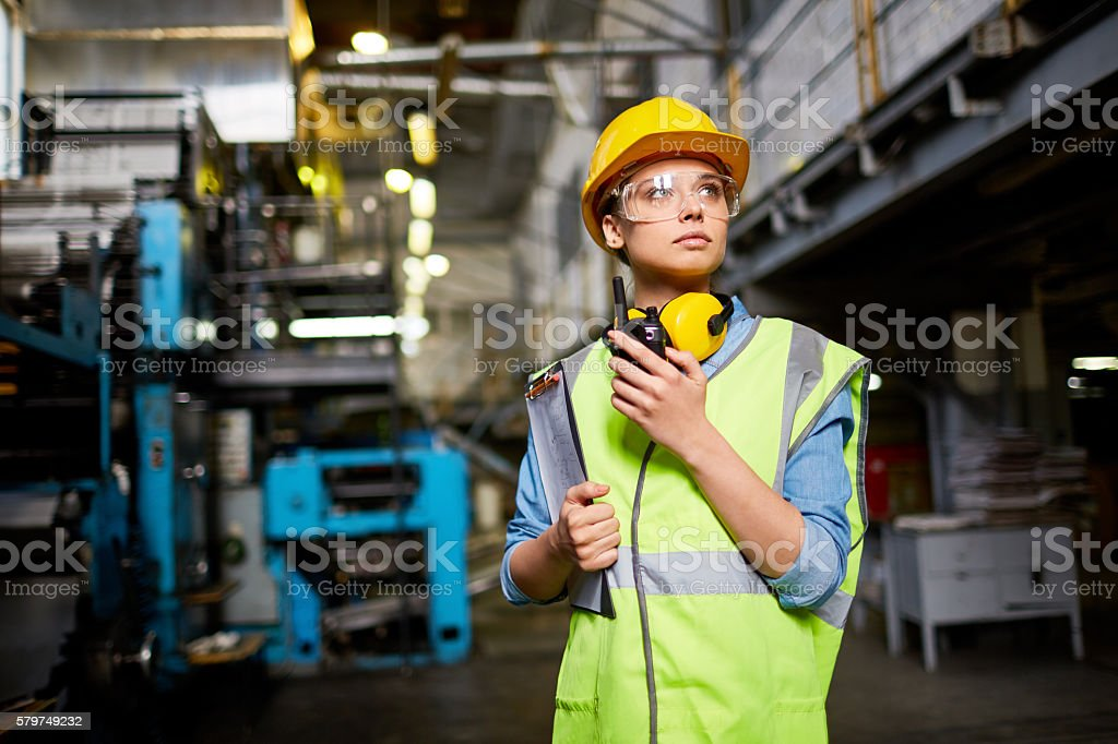 Pretty young engineer stock photo