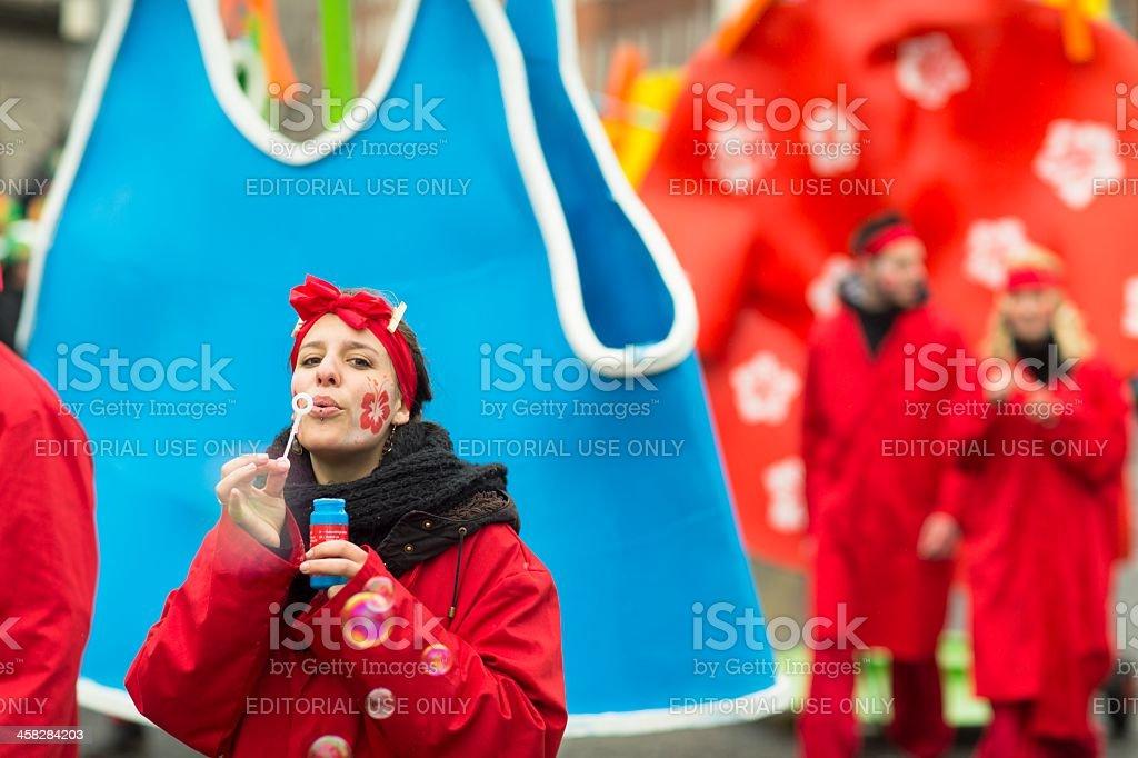 Pretty young female makes soap bubbles stock photo