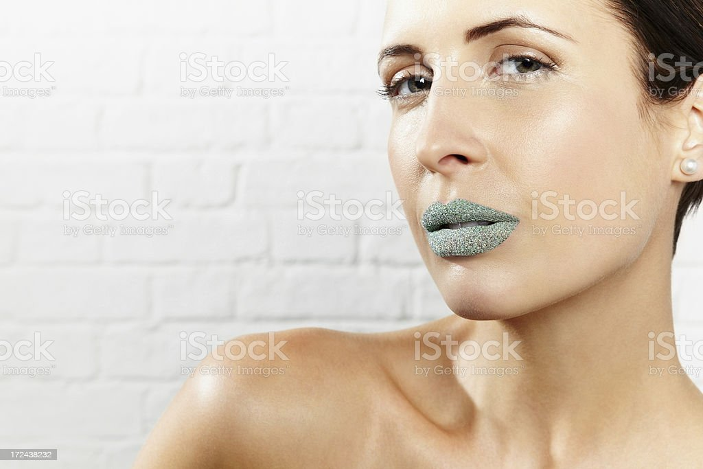 Pretty young female model with creative lips makeup royalty-free stock photo