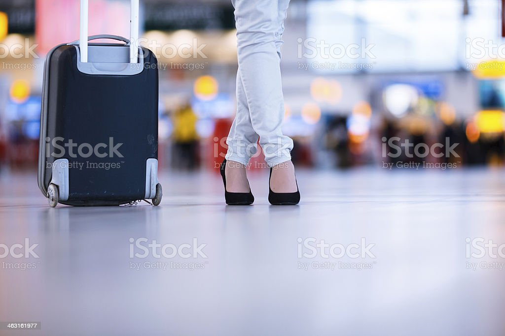 Pretty young female passenger at the airport stock photo