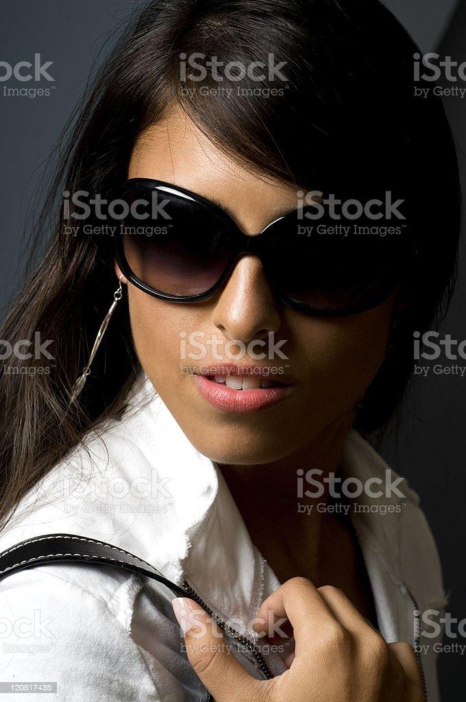 Pretty Young Female Posing In Fashion Sunglasses stock photo