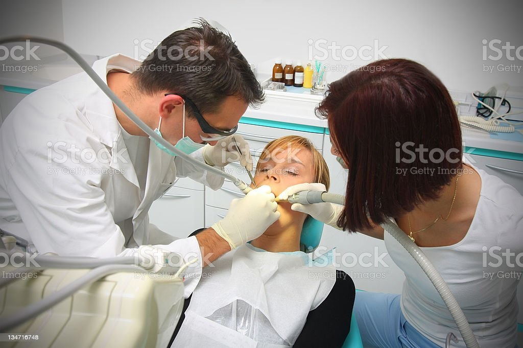 Pretty young girl at the dentist royalty-free stock photo