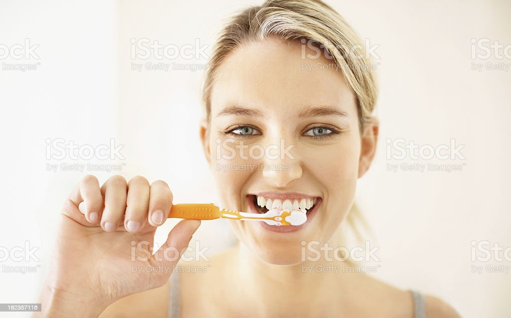Pretty young girl brushing her teeth royalty-free stock photo