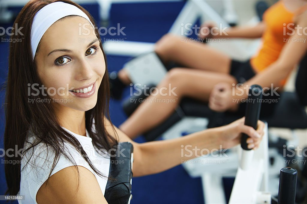 A pretty young girl exercising in the gym royalty-free stock photo