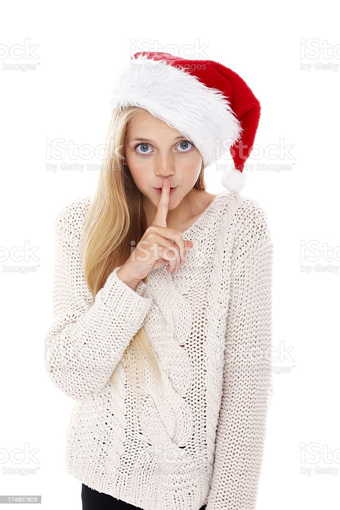 Pretty young girl gesturing silence against white royalty-free stock photo